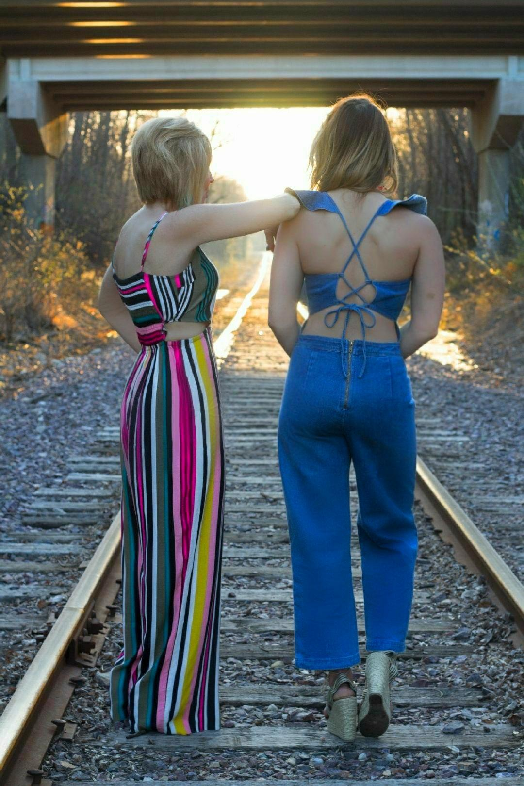 Colleen and I jumpsuits on the tracks